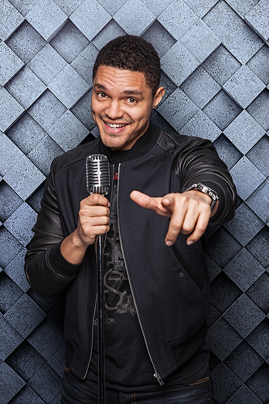 Trevor Noah with microphone by Paul Mobley